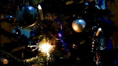 Sparkler on christmas tree — Stock Video