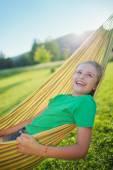 Summer joy  - lovely girl in hammock  in the garden — Stock Photo