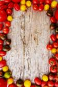 Frame of paprika family varieties over a rustic wooden background — Stock Photo