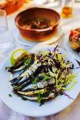 Grilled sardines, traditional Mediterranean dish — Stock Photo