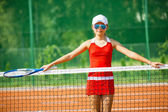 Tennis - beautiful young girl tennis player on the tennis court — Stock Photo