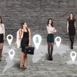 Four women standing in front of an earth map — Stock Photo #68542569