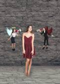 Pretty young woman thinks, an angel and a devil — Stock Photo