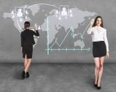 Business woman draw a map on the wall — ストック写真