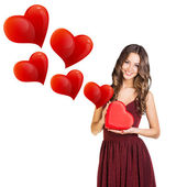 Attractive woman with gift box — Stock Photo