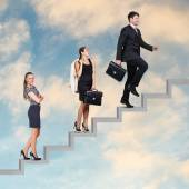 Three business people walking on the ladder — Stock Photo
