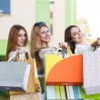 Young women after shopping — Stock Photo #71175279