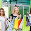 Young women after shopping — Stock Photo #71176025