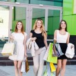 Young women after shopping — Stock Photo #73015175