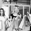 Young women after shopping — Stock Photo #74329149
