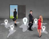 Businesspeople on a map — Stock Photo