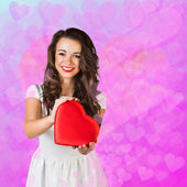 Woman with a valentine heart — Stock Photo