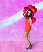 Woman with valentine baloons — Stock Photo