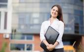 Happy business woman holding laptop and smiling  — Stock Photo