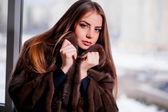Fashion Winter beauty in fur coat over black — Stock Photo