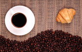 Croissants coffee and beans  — Stock Photo