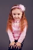 Beautiful young elementary age school girl with long curly red h — Fotografia Stock