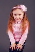 Beautiful young elementary age school girl with long curly red h — Stockfoto