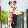 A love story. A man and a woman beautiful couple near the water — Stock Photo #77915268