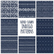 Set of eight indigo blue and white seamless hand drawn geomtric textures — Stock Vector #75657115