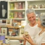 Senior couple in shopping center — Stock Photo #52163227