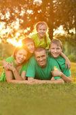 Family in green jerseys — Stock Photo