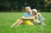 Beautiful old couple in field — Stock Photo