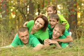 Family in green jersey — Stock Photo