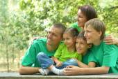 Family in green jersey resting — Stock Photo