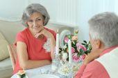 Happy elderly couple having dinner — Stock Photo