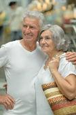 Beautiful elderly couple in shopping mall — Stock Photo