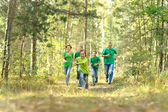 Happy cheerful family running — Stock Photo