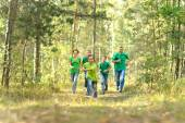 Happy cheerful family running — Stok fotoğraf