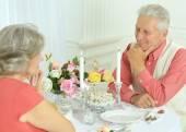 Happy elderly couple having dinner — Стоковое фото