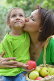 Mother and her daughter eating — Stock Photo