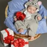 Baby girl sleeping with gifts — Stock Photo #52566121