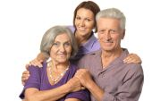 Adult daughter with senior parents — Stock Photo