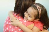Little girl hugging her mother — Stock Photo
