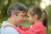 Father hugging his little daughter  in nature — Stock Photo