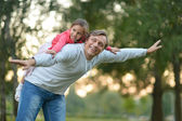 Father with her little daughter in nature — Stock Photo