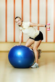 Woman at the gym with a pilates ball — Stock Photo