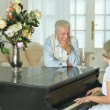 Senior woman playing the piano — Stock Photo #53509709