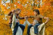 Grandparents and grandchildren in autumn park — Stock Photo