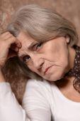 Sad senior woman — Stock Photo