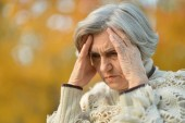 Pensive elderly woman — Stock Photo