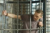 Man in cage — Stock Photo