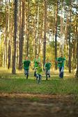 Happy cheerful family running — Stock Photo