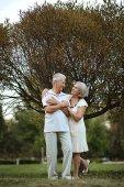 Mature couple  in the  autumn park — Stock Photo
