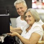 Senior couple in shopping center — Stock Photo #54460541