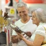 Senior couple in shopping center — Stock Photo #54461247